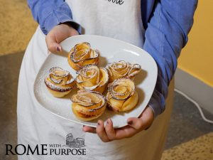 Making apple rose pastries at Italian cooking classes